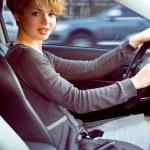 Beautiful blonde woman driving — Stock Photo