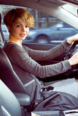 Beautiful blonde woman driving — Stock Photo