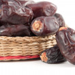 Dates fruits in wicker basket - isolated — Stock Photo