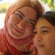 Muslim woman and her daughter — Stock Photo