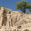 Statues on Mount Nemrut Turkey - Stock Photo