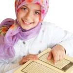 Little muslim girl read her Koran — Stock Photo