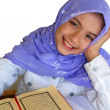 Little muslim girl read her Koran - Stock Photo