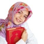 Little muslim girl hold her Koran — Stock Photo