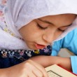 Stock Photo: Little muslim girl read her Koran