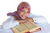 Little muslim girl read her Koran — Stock Photo