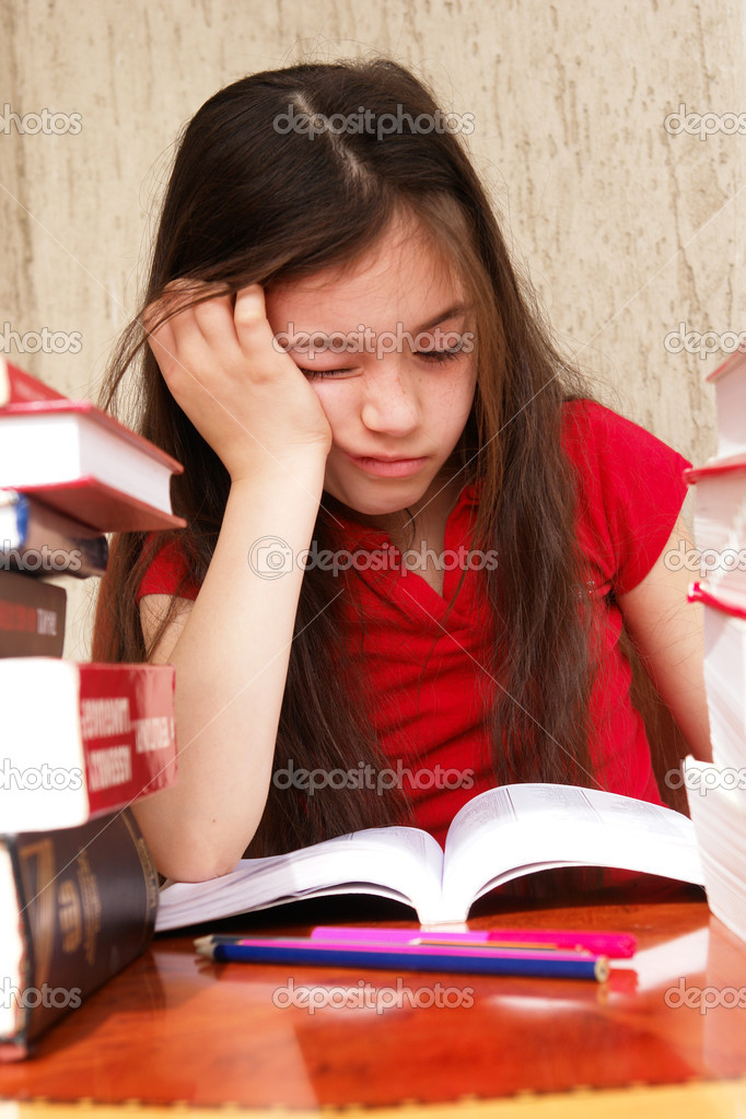 Girl studies homework - bored — Stock Photo #2205921