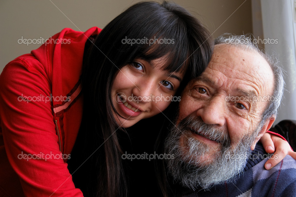 Grandfather and granddaughter smiles to camera — Stock Photo #2207239