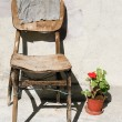 Vintage scene with very old chair — Stock Photo