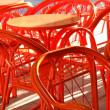 Metal orange cafe table and chairs - Stock Photo