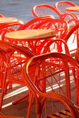 Metal orange cafe table and chairs — Stock Photo