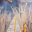 Candles in a Buddhist temple - Bangkok - Stock Photo