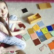 girl plays traditional tangram game — Stock Photo