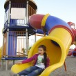 Little girl slides in playground — Foto de stock #2269763