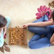 Sisters play chess - top view — Stock Photo