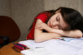 Girl sleeps on homework — Stock Photo