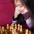 Little girl play chess game — Stock Photo