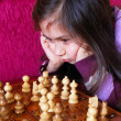 Little girl play chess game - Stock Photo