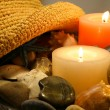 Hat, candles and rocks — Stock Photo
