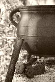 Antique iron cooking pot — Stock Photo