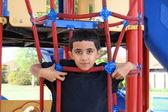 Hispanic child on the playground — Stock Photo