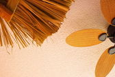 Palm leaves hut and ceiling fan — Stock Photo