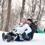 Couple riding a sleigh — Stock Photo