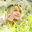 Pretty girl blonde on a lawn — Stock Photo