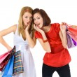 Royalty-Free Stock Photo: Two pretty girls with purchases