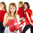 Girls in red with the presents. — Stock Photo