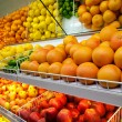 Stock Photo: Counter with fruit in supermarket
