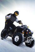 Rider costs near to ATV. Winter season — Stock Photo