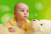 The baby and teddy bea — Stock Photo
