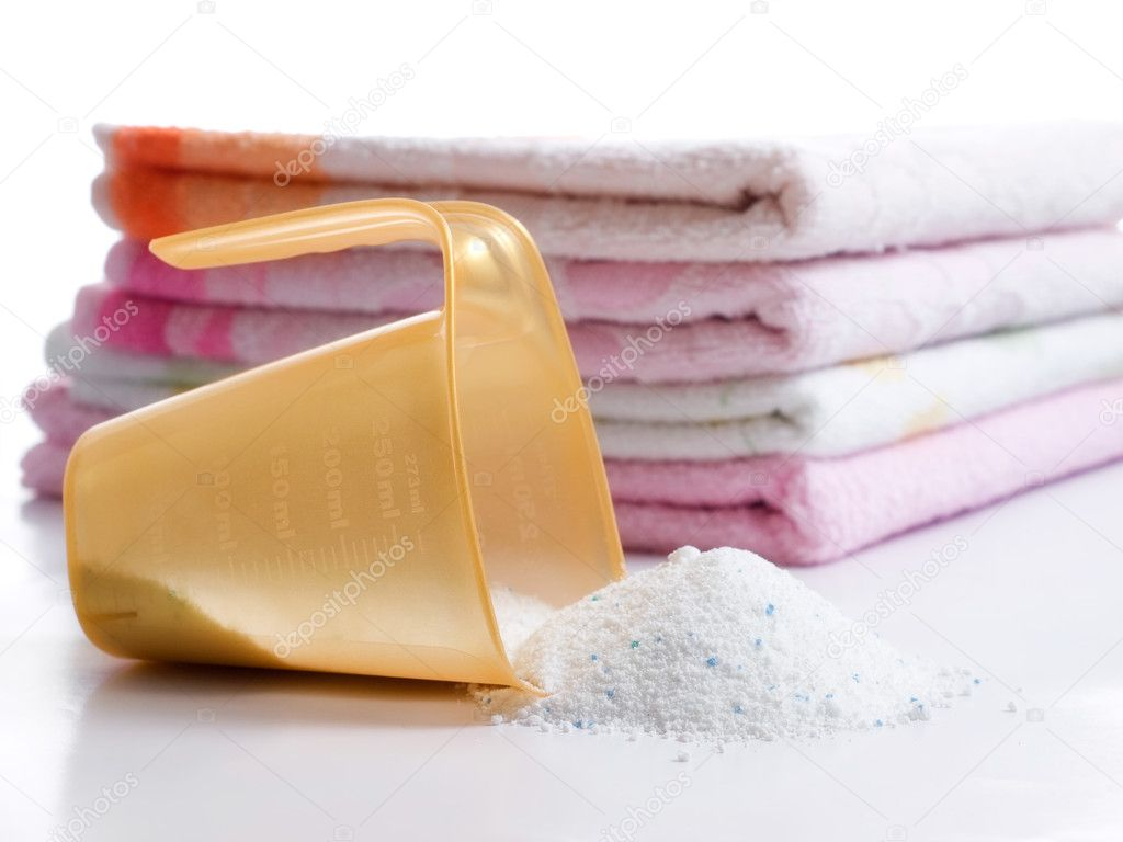 Detergent for washing machine in laundry with towels in the background.  Stock Photo #2326807