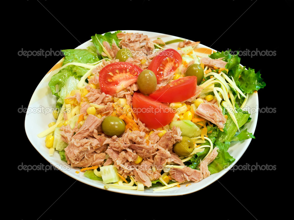 Tuna salad with mixed vegetables and cheese on black background.  Stock Photo #2684096
