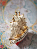 Ship on old map — Stock Photo