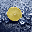 Lemon &amp; ice cubes - Stock Photo