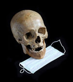 Skull and medical mask — Stock Photo