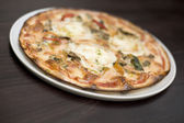 Goats cheese and roasted vegatable pizza — Stock Photo
