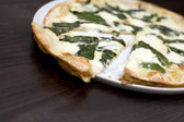 Mixed cheese and spinach pizza — Stock Photo