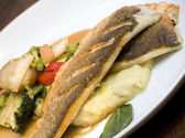 A dish of grilled seabass with vegetables. — Stock Photo