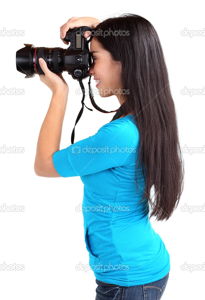 A female photographer is shooting someone or something. — Stock Photo #1973350