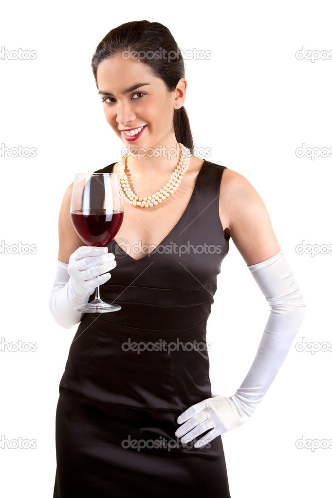A beautiful smiling woman in a classy dress is holding a glass of red wine. — Stock fotografie #1973588