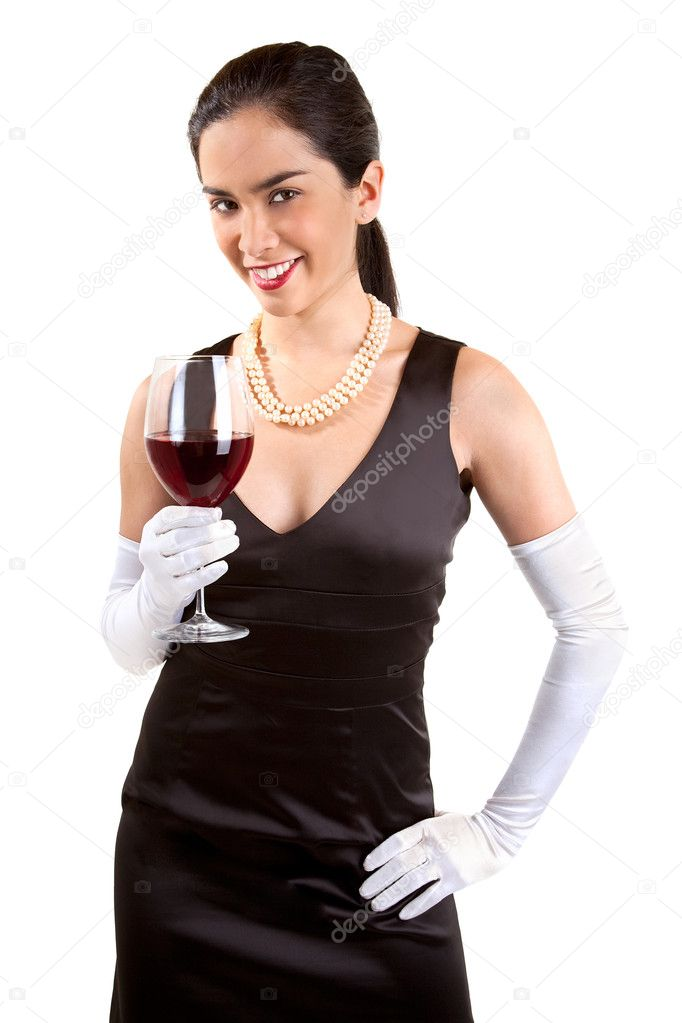 A beautiful smiling woman in a classy dress is holding a glass of red wine. — Zdjęcie stockowe #1973588