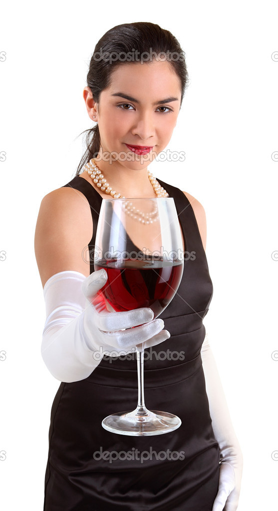 A beautiful woman in a classy dress is serving a glass of red wine. — Stock Photo #1973596