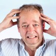 Man Suffering from a Headache - Stock Photo