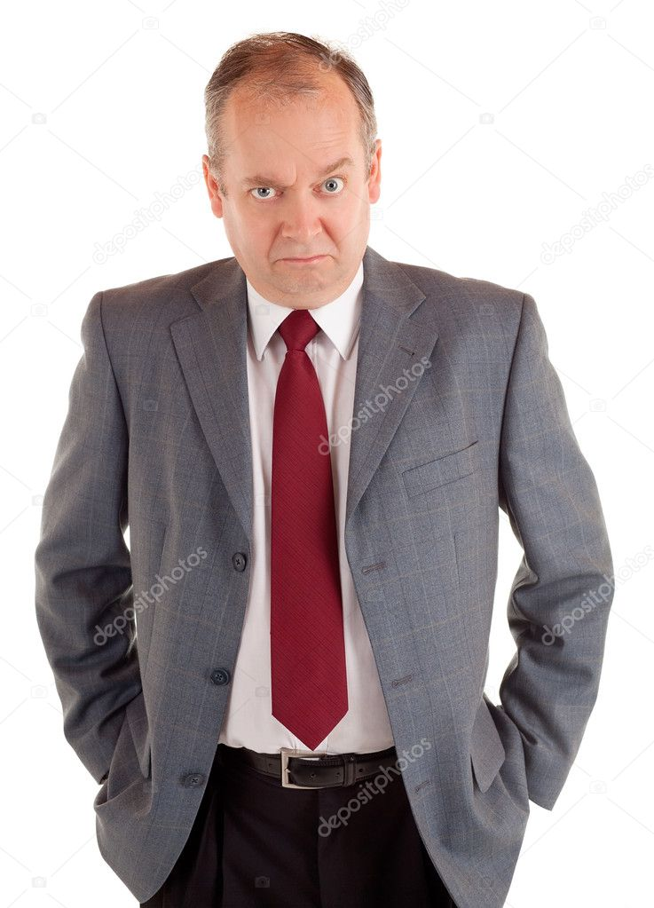A  businessman is standing and seriously looking at the camera with a scowling expression. — Stock Photo #2028593