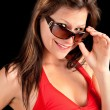 Foto Stock: Girl Looking Over Sunglasses