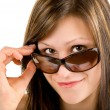Beautiful Girl Looking Over Sunglasses — Stok fotoğraf