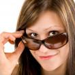 piękna dziewczyna patrząc na okulary — Zdjęcie stockowe #2031220